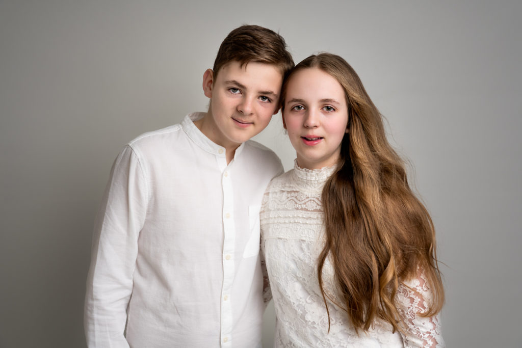 brother and sister posing studio